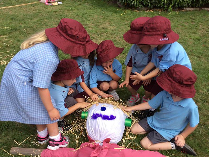 Children making a scarecrow